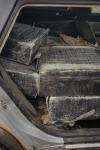 Autoturism burdușit cu ţigări de contrabandă, reținut cu focuri de armă - FOTO