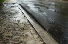 Primim la Redacţie - Noul strat asfaltic este un dezastru – FOTO