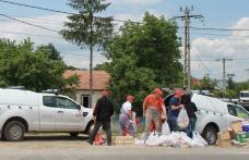 Voluntarii E.ON au ajutat familiile afectate de inundaţiile din judeţul Bacău - FOTO
