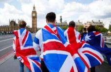 Marea Britanie are în vedere reguli mai aspre pentru angajarea lucrătorilor străini