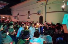 Lumina Sfântă a adus fericirea pe chipul credincioșilor din Dorohoi care au participat la slujba de Înviere – FOTO