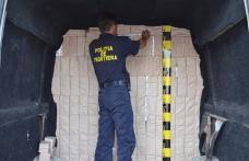Microbuz blindat cu peste 27.400 de pachete cu ţigări, reţinut de poliţiştii de frontieră - FOTO