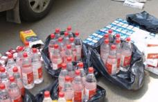 Ţigări și alcool de contrabandă, confiscate de poliţişti din Piaţa Dorohoi