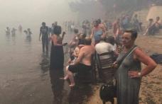 Imaginile tragediei din Grecia: Trupuri carbonizate, găsite îmbrățișate la câțiva metri de mare