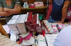 Tupeu de comerciant! Prinși în timp ce vindeau țigări de contrabandă pe sub tejghea