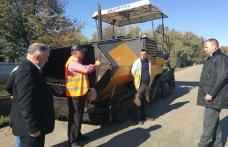 S-a dat startul lucrărilor de asfaltare pe drumul județean Vorona – Poiana - Sarafinești - FOTO