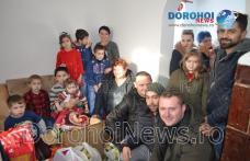 Gest emoționant în prag de Crăciun: Un grup de dorohoieni a adus zâmbete pe chipurile unei familii - FOTO