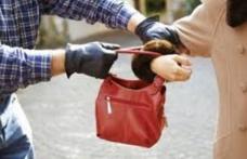 24 de ore după gratii! Un tânăr a tras de poșeta unei femei pe strada 1 Decembrie