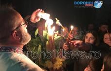 Slujba de Înviere: Fericire pe chipul credincioșilor din Dorohoi și împrejurimi adusă de Lumina Sfântă – FOTO