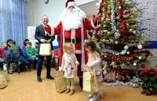 Moș Crăciun a oferit cadouri la sediul PSD Botoșani - FOTO