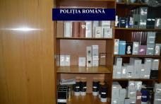 Sute de parfumuri și articole de îmbrăcăminte confiscate în urma unor percheziţii - FOTO
