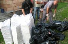 Șapte colete cu ţigări găsite într-o locuinţă părăsită