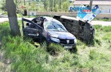 Accident la Dragalina! Bărbat rănit după ce două mașini s-au răsturnat în afara părții carosabile - FOTO