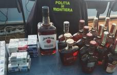 Alcool și țigări de contrabandă, depistate de poliţiştii de frontieră - FOTO