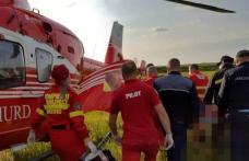 Misiune contracronometru la Botoșani! Bărbat preluat de elicopterul SMURD după ce și-a prins piciorul la o motosapă - FOTO