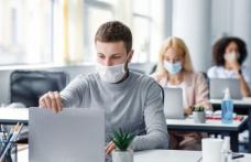 Masca nu va mai fi obligatorie la locul de muncă pentru cei vaccinați, din 1 iunie, în anumite condiții