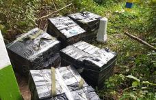 Ţigarete de contrabandă abandonate în vegetaţie la vederea poliţiştilor de frontieră - FOTO