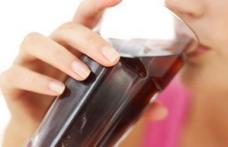 Cât trebuie să alergi pentru a consuma caloriile dintr-un pahar de Coca-Cola