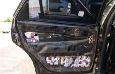 Portiere de Audi căptuşite cu ţigări de contrabandă