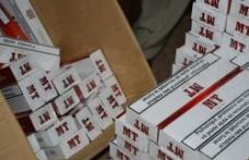 8.000 de ţigarete de contrabandă descoperite într-un Opel