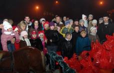 [FOTO] Moş Crăciun a venit la Dorohoi cu sania trasă de... ponei