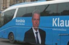 Klaus Iohannis cară oamenii cu autocarul la miting