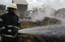 Furaje incendiate de un copil de 5 ani